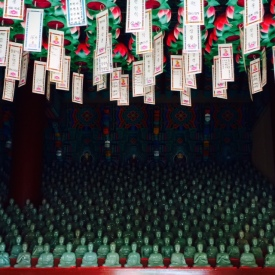 Prayer cards and jade Buddhas