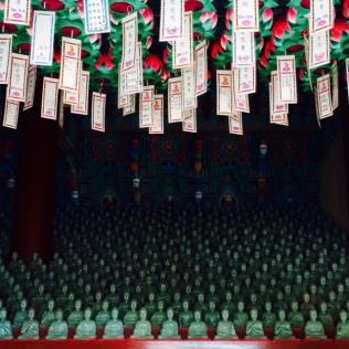 Prayer cards and jade Buddhas